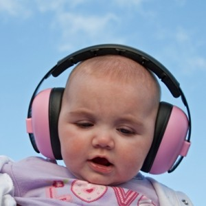 baby with earmuffs