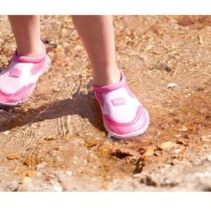 girl wearing swim shoes
